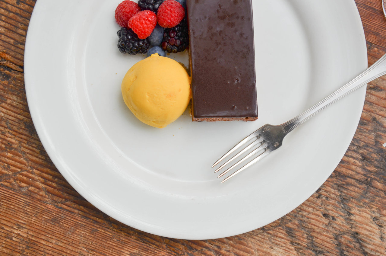 Vegan chocolate tart with passion fruit sorbet