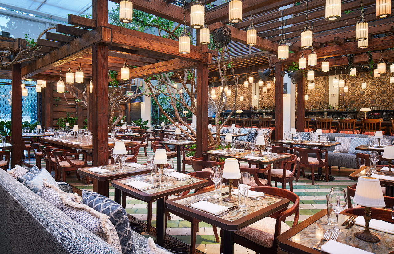 An open-roofed restaurant with hanging lanterns